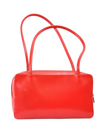 female red leather handbag against white background, minimal shadow in front Stock Photo - 2650046