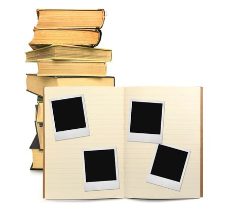 lined exercise book and photo frames, visible natural shadow in front Stock Photo - 2650051