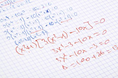 retrieve: hand written maths calculations with teachers corrections in red