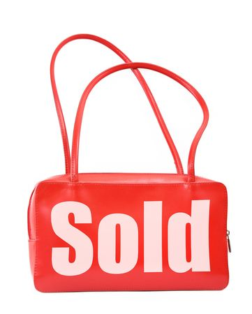red leather handbag with sold sign on white background, minimal natural shadow in front, the photo does not infringe any copyright Stock Photo - 2773304