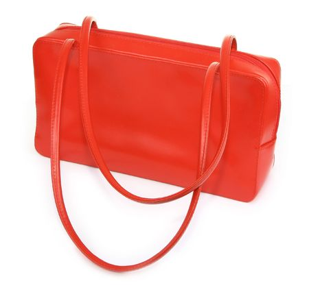 red leather handbag against white background, minimal natural shadow underneath