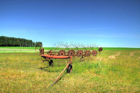 old farm machine on a field, focus set on machine Stock Photo - 3126077