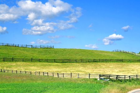 summer country view with fields and wooden fences, focus set in foreground photo