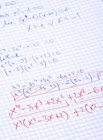 hand written maths calculations with teachers corrections in red   photo