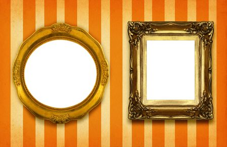 two hollow gilded frames on striped background