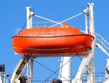 lifeboat: red lifeboat against cloudless sky