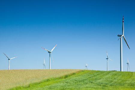 group of wind turbines on field photo