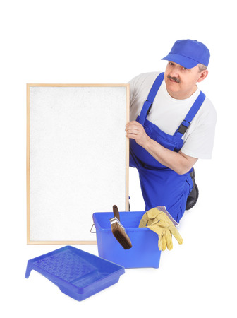 House painter and empty white board over white background photo