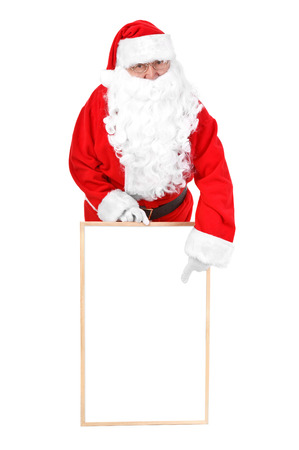 Santa claus and empty white board  photo