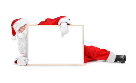 Santa and empty white board over white background photo