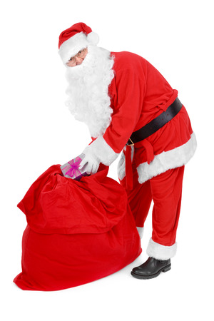 sackful: Santa reaches for a gift over white background