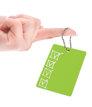 name tags: female hand holding empty tag with completed checklist on white background