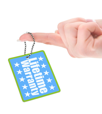 surety: female hand showing warranty tag over white background