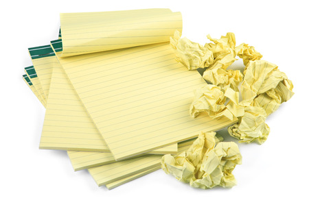 memorise: blank lined notebooks and crumpled paper on white background, natural shadow in front