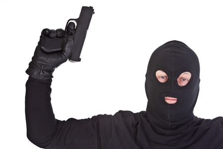 horrifying: bandit with gun over pure white background