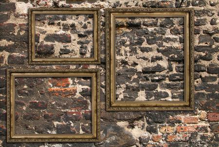 threefold: Three wooden frames over ruined brick wall Stock Photo