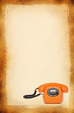 bakelite: classic bakelite telephone over stained paper background