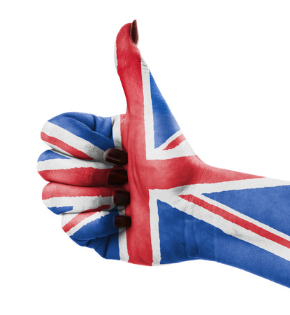 Thumb up for Great Britain over white background photo