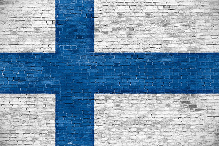 finnish: Finnish flag over old brick wall