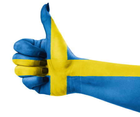 all european flags: National flag of Sweden over hand . Stock Photo