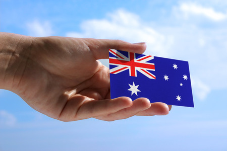jack up: Female hand holding small flag of Australia