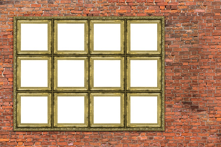 Huge empty golden frame over old brick wall photo