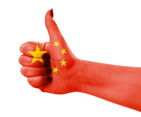 National flag of China on female hand photo
