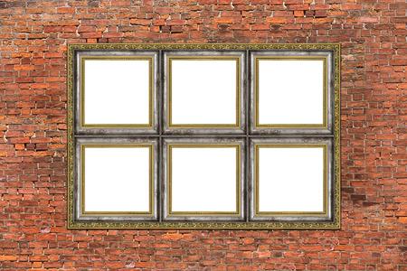 Strange empty golden frame over old brick wall photo