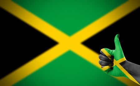 satisfy: Flag of Jamaica painted on hand Stock Photo