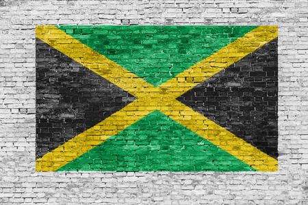 jamaican flag: Flag of Jamaica painted over white brick wall Stock Photo