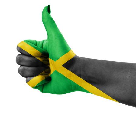 rastaman: Flag of Jamaica painted on hand Stock Photo