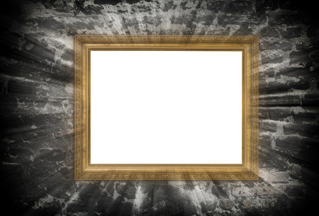 hollow walls: gold wooden frame with light beams over ruined brick wall Stock Photo