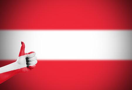 approbation: Flag of Austria over females hand, focus set on hand