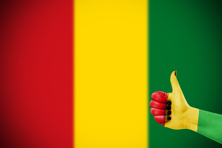 approbation: Colors of reggae music applied on hand Stock Photo