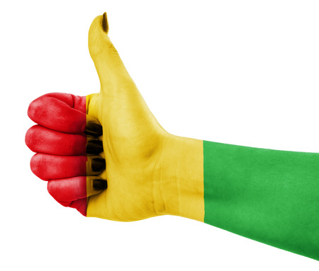 satisfy: Colors of reggae music applied on hand Stock Photo
