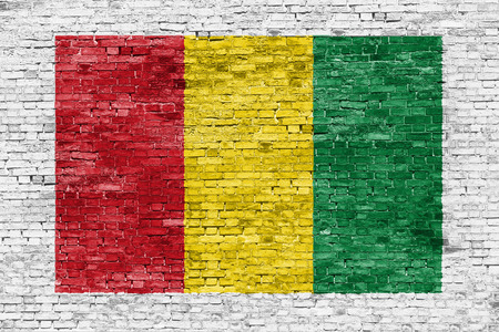 reggae: Reggae colors painted over white brick wall