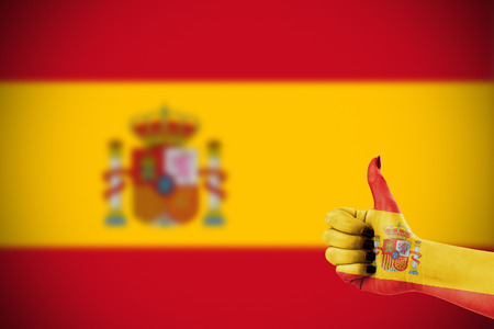affirmative: Flag of Spain over females hand Stock Photo