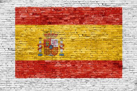 white brick: Spanish flag painted on white brick wall