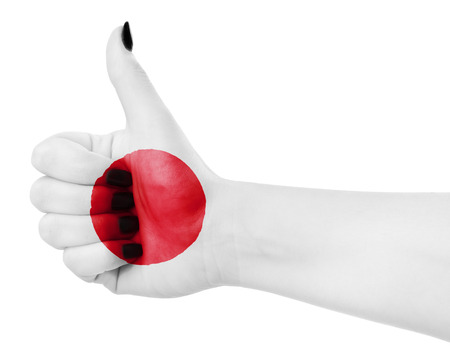 thumbup: Flag of Japan on females hand