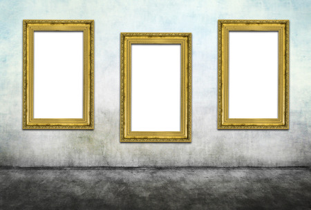 framed picture: Three vertical golden frames on dirty wall