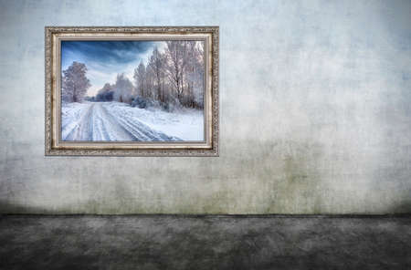 art exhibition: Old wooden frame with beautiful winter landscape on dirty wall. There is no copyright infringement, photo inside is my property.