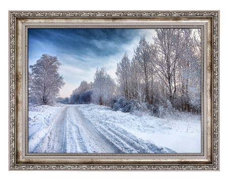framed picture: Old wooden frame with beautiful winter landscape isolated on white background. Photo inside is my property