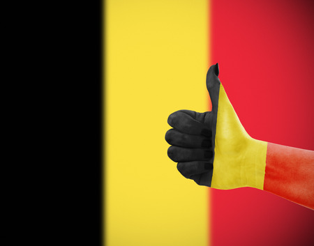 thumbup: Flag of Belgium on females hand, second defocused flag in background Stock Photo