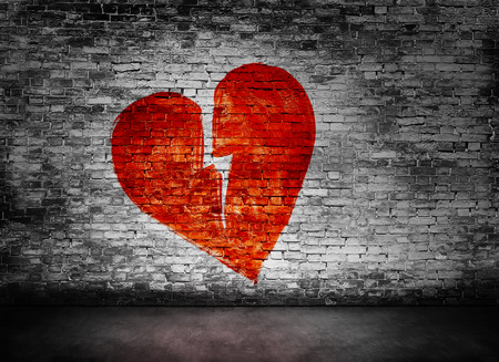 damaged: Shape of broken heart on murky brick wall Stock Photo