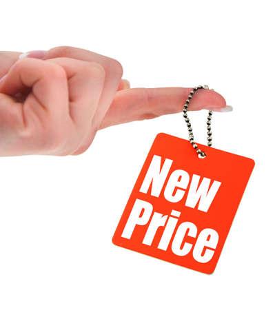 pricetag: hand holding price tag, photo does not infringe any copyright, shallow DOF Stock Photo
