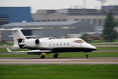 corporate jet landing at airport Stock Photo
