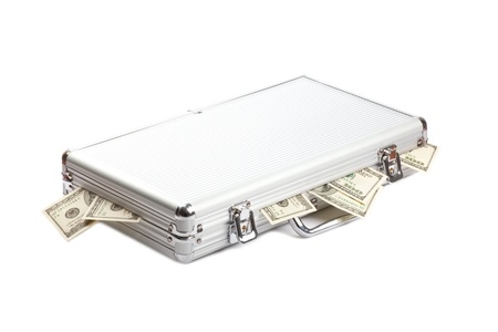 dollars money in the metall suitcase isolated over white background photo