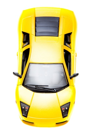 yellow toy sportcar isoladed over white background photo