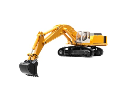 open cast mine: toy heavy excavator isolated over white background Stock Photo
