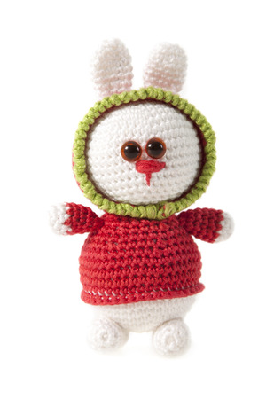 knitted rabbit isolated over white background photo
